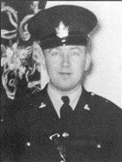 A black and white photo of a police officer
