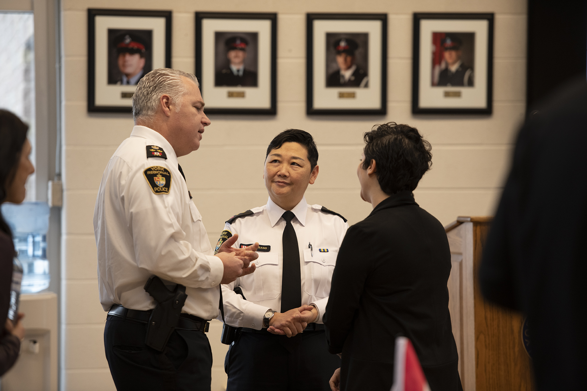 A male and female officer talk to a citizen at an event