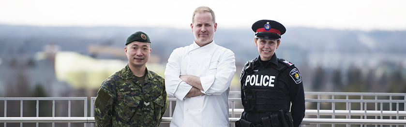 A military officer, chef and police officer in a group