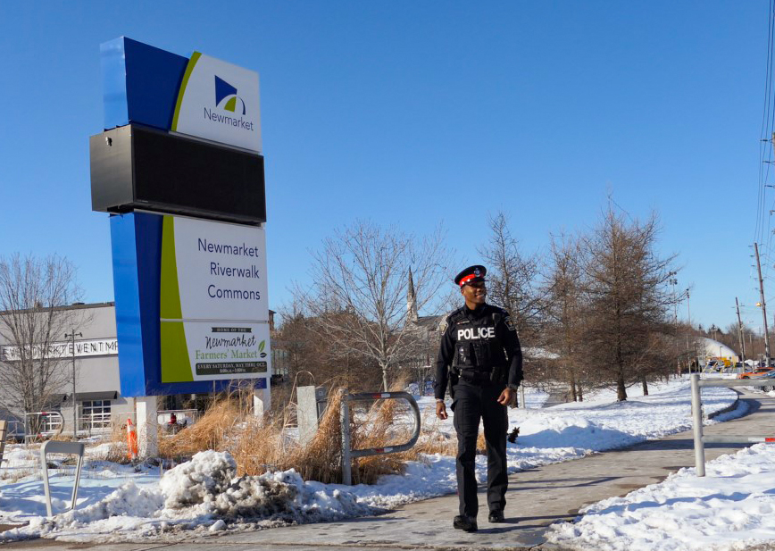 An officer in uniform patrolling the streets of Newmarket