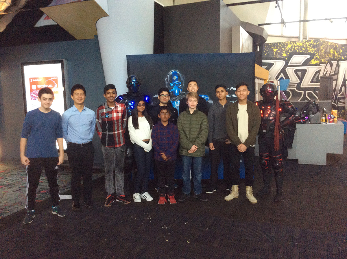 A group of teens pose for a picture with YRP's two superheroes