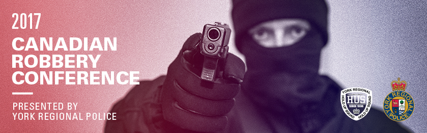 An image of a robber wearing a balaclava and holding a gun