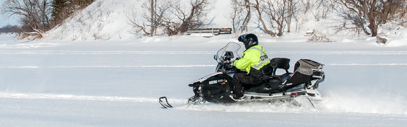 An officer on a snowmobile
