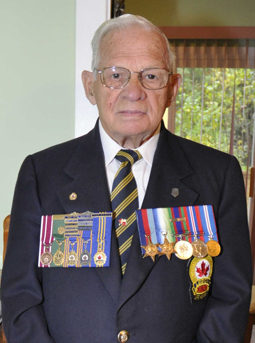 A man wears medals on his chest